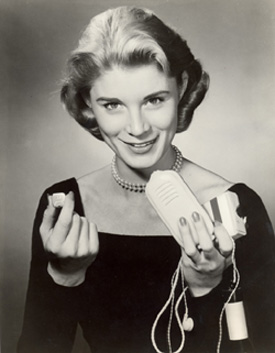 Publicity photo for the Sonotone Model 222 hearing aid, 1957